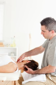 chiropractor working on patient's neck