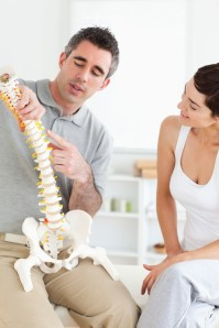 chiropractor with spine model
